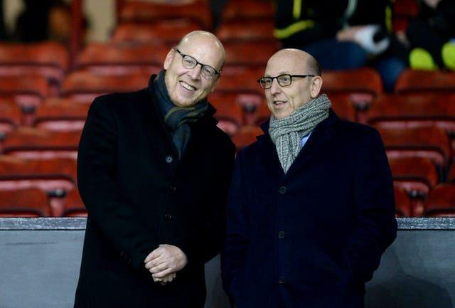 Joel Glazer (right) admits United got it wrong over the European Super League