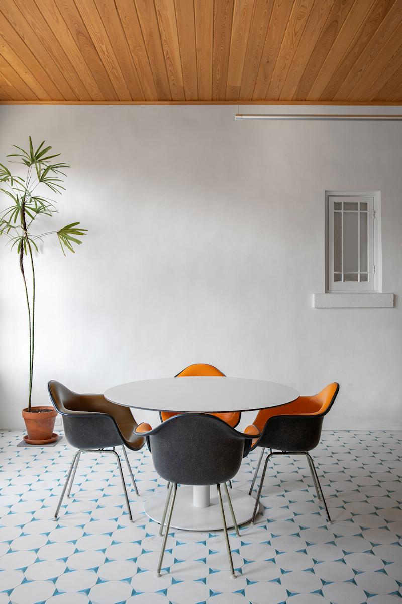 AFTER: The amazing pinwheel floor tiles are a collaboration between Oh Joy! and Clé Tile. The chairs are original Herman Miller Eames chairs from Jody's grandmother.