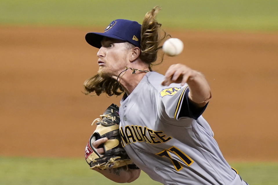 Milwaukee Brewers relief pitcher Josh Hader throws during the ninth inning of a baseball game against the Miami Marlins, Saturday, May 8, 2021, in Miami. The Brewers won 6-2. (AP Photo/Lynne Sladky)