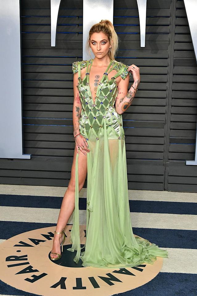 <p>Michael Jackson's daughter showed off her tattooes in a dramatically cut seafoam green creation for the<em> Vanity Fair</em> party. (Photo: Dia Dipasupil/Getty Images) </p>