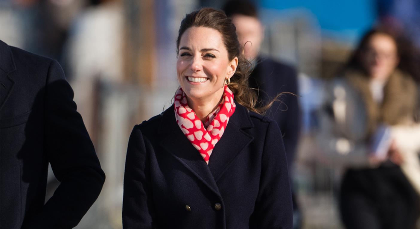 The Duchess of Cambrige wore a Hobbs coat and heart-adorned scarf in South Wales on Tuesday. [Photo: Getty]