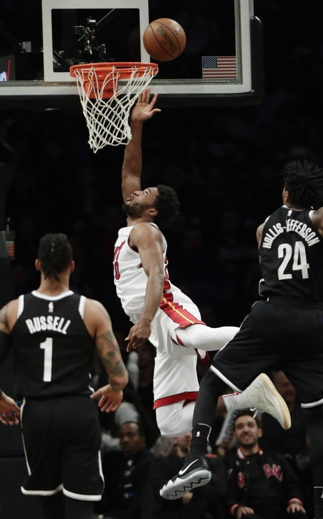 Miami Heat's Justise Winslow (20) drives past Brooklyn Nets' Rondae Hollis-Jefferson (24) during the second half of an NBA basketball game Friday, Jan. 19, 2018, in New York. (AP Photo/Frank Franklin II)