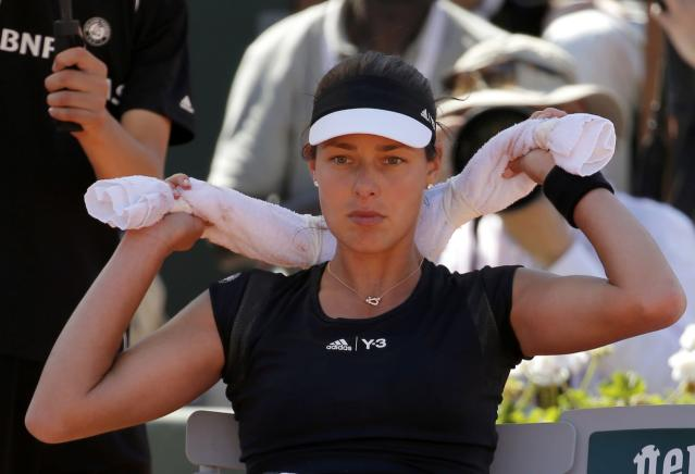 Ana Ivanovic of Serbia sits during a break in her women's semi-final match against Lucie Safarova of the Czech Republic during the French Open tennis tournament at the Roland Garros stadium in Paris, France, June 4, 2015. REUTERS/Vincent Kessler