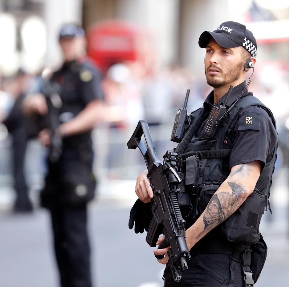 A London police officer showcasing his tattoos while on duty [Photo: Getty]