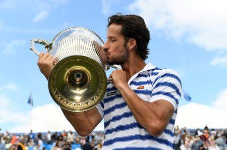 Feliciano Lopez battles back against Marin Cilic for victory at Queen's
