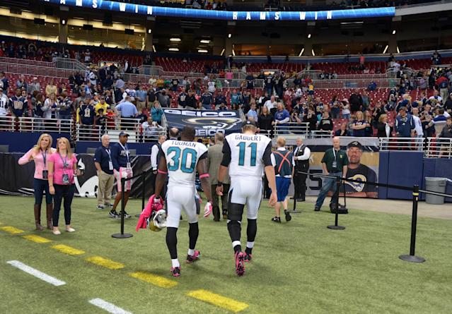 Jacksonville Jaguars quarterback Blaine Gabbert (11) and teammate running back Jordan Todman (30) walk off the field following a 34-20 loss to the St. Louis Rams in an NFL football game Sunday, Oct. 6, 2013, in St. Louis. Gabbert left the game in the third quarter with a reported hamstring injury. (AP Photo/L.G. Patterson)
