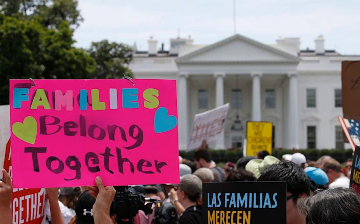 Activists march at the White House to protest the Trump administration's approach to illegal border crossings and separation of children from immigrant parents, on June 20, 2018. (Photo: Alex Brandon/AP)