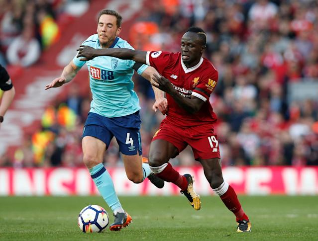 "Soccer Football - Premier League - Liverpool vs AFC Bournemouth - Anfield, Liverpool, Britain - April 14, 2018 Bournemouth's Dan Gosling in action with Liverpool's Sadio Mane REUTERS/Andrew Yates EDITORIAL USE ONLY. No use with unauthorized audio, video, data, fixture lists, club/league logos or ""live"" services. Online in-match use limited to 75 images, no video emulation. No use in betting, games or single club/league/player publications. Please contact your account representative for further details."