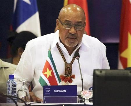 Suriname's President Desi Bouterse speaks during a working session at a Union of South American Nations (UNASUR) leaders summit, in Paramaribo