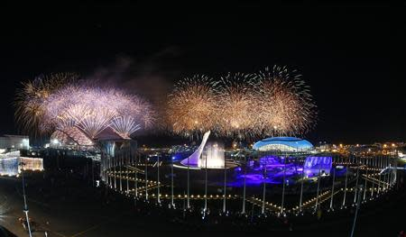 Fireworks explode over the Olympic Park during the closing ceremony for the 2014 Sochi Winter Olympics, February 23, 2014. REUTERS/Shamil Zhumatov