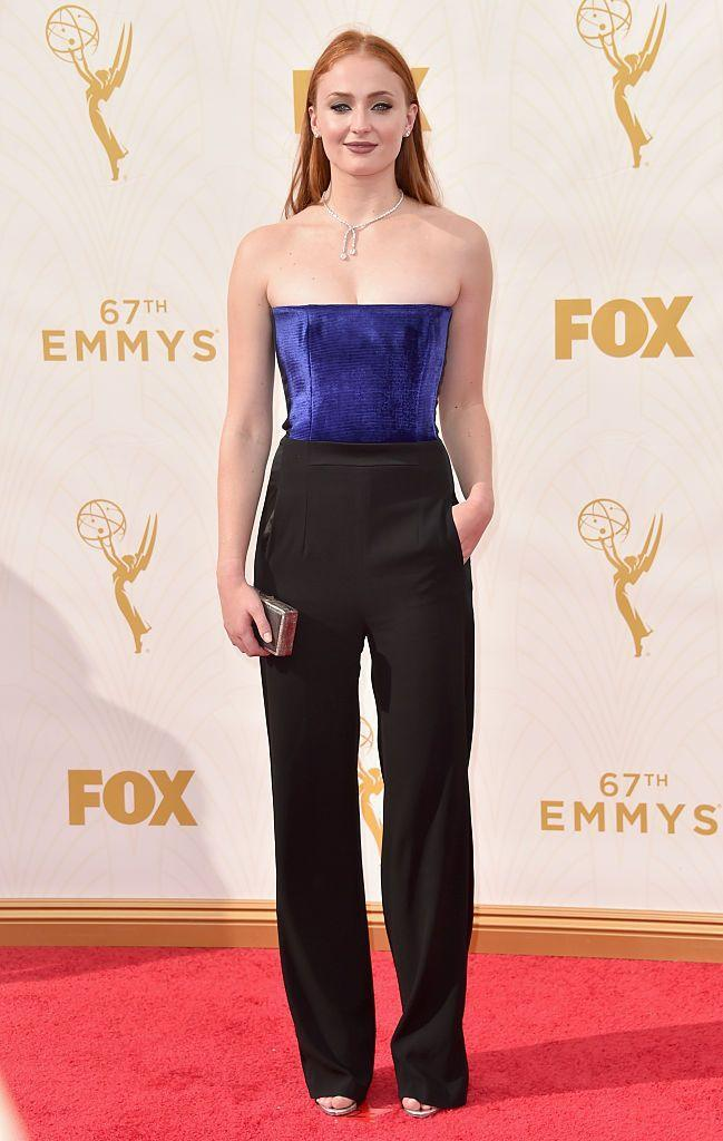 <p>The GOT star departed from a dress to wear a blue bandeau top and black high-waisted trousers by Galvan with a Forevermark diamond necklace.</p>