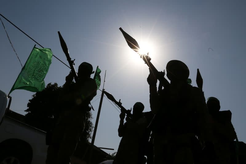 Palestinian Hamas militants take part in an anti-Israel military show in the southern Gaza Strip