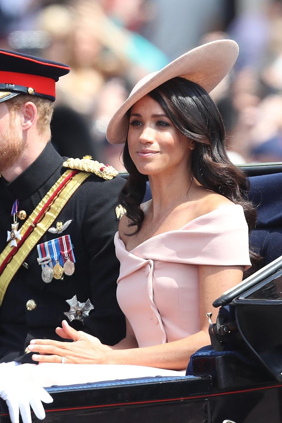 <p>The Duchess wore a powder pink Carolina Herrera off-the-shoulder outfit for Trooping the Colour in June 2018, which is believed to have cost around £3,045 [Photo: Getty] </p>