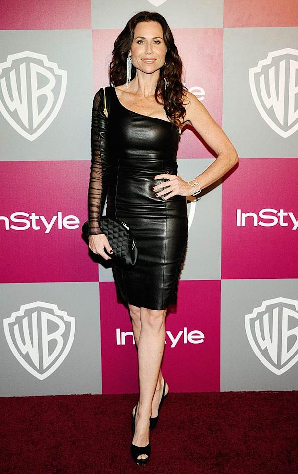 """At InStyle and Warner Bros. Globes after party, Minnie Driver flaunted her toned figure in a skintight leather asymmetrical number, which featured a sexy sheer sleeve. The """"Barney's Version"""" actress paired her dress with black peep-toes and a quilted clutch. Kevork Djansezian/<a href=""""http://www.gettyimages.com/"""" target=""""new"""">GettyImages.com</a> - January 16, 2011"""