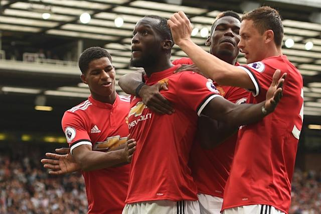 """<a class=""""link rapid-noclick-resp"""" href=""""/soccer/teams/manchester-united/"""" data-ylk=""""slk:Manchester United"""">Manchester United</a>'s <a class=""""link rapid-noclick-resp"""" href=""""/soccer/players/romelu-lukaku/"""" data-ylk=""""slk:Romelu Lukaku"""">Romelu Lukaku</a> celebrates with teammates after scoring a goal during their English Premier League match against <a class=""""link rapid-noclick-resp"""" href=""""/soccer/teams/west-ham-united/"""" data-ylk=""""slk:West Ham United"""">West Ham United</a>, at Old Trafford in Manchester, on August 13, 2017 (AFP Photo/Oli SCARFF )"""