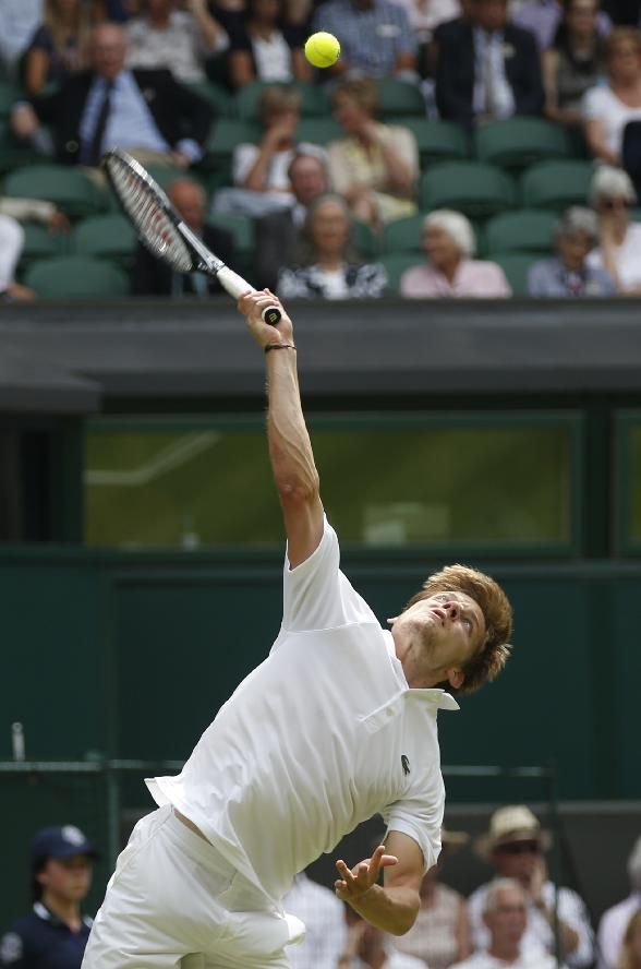 David Goffin of Belgium serves to Andy Murray of Britain during their first round match at the All England Lawn Tennis Championships in Wimbledon, London, Monday, June 23, 2014. (AP Photo/Pavel Golovkin)