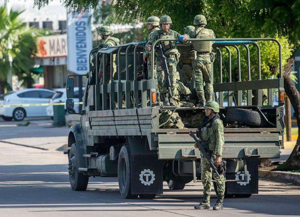 PHOTO: Mexican soldiers patrol around the city a day after a gun battle between gunmen and security forces in Culiacan, Mexico, on Oct. 18, 2019. (Augusto Zurita/AP)