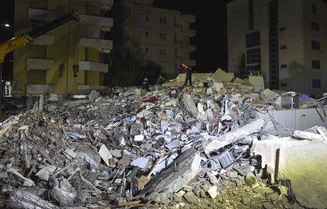 Members of Turkey's Disaster and Emergency Management Authority conduct a search and rescue operation at collapsed buildings in Durres (Getty)