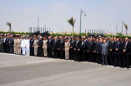 Egyptian President Abdel Fattah al-Sisi (C) and government ministers attend Egyptian public prosecutor Hisham Barakat's military funeral service at the Field Marshal Mohammed Hussein Tantawi Mosque, in Cairo, Egypt, in this June 30, 2015 handout picture courtesy of the Egyptian Presidency. REUTERS/The Egyptian Presidency/Handout via Reuters