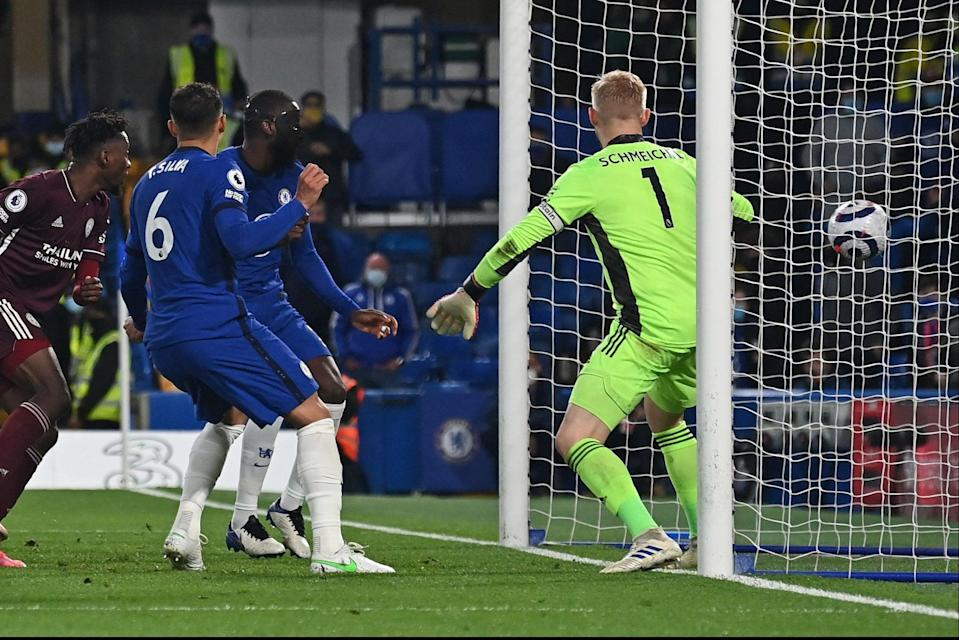 <p>On target: Antonio Rudiger, wearing a face mask, puts Chelsea ahead against Leicester</p> (POOL/AFP via Getty Images)