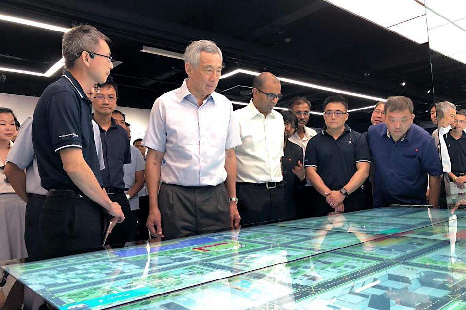 Prime Minister Lee Hsien Loong led on a guided tour of the new SG Mobility Gallery at the Land Transport Authority headquarters on Wednesday, 19 September 2018. To his left, Senior Minister of State for Transport Janil Puthucheary looks on. PHOTO: Nicholas Yong/Yahoo News Singapore