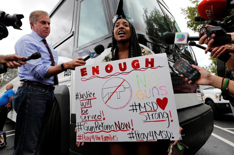 Student: Tyra Hemans, 19, a senior, speaks before boarding busses with other students to travel to the state's Capitol (REUTERS)