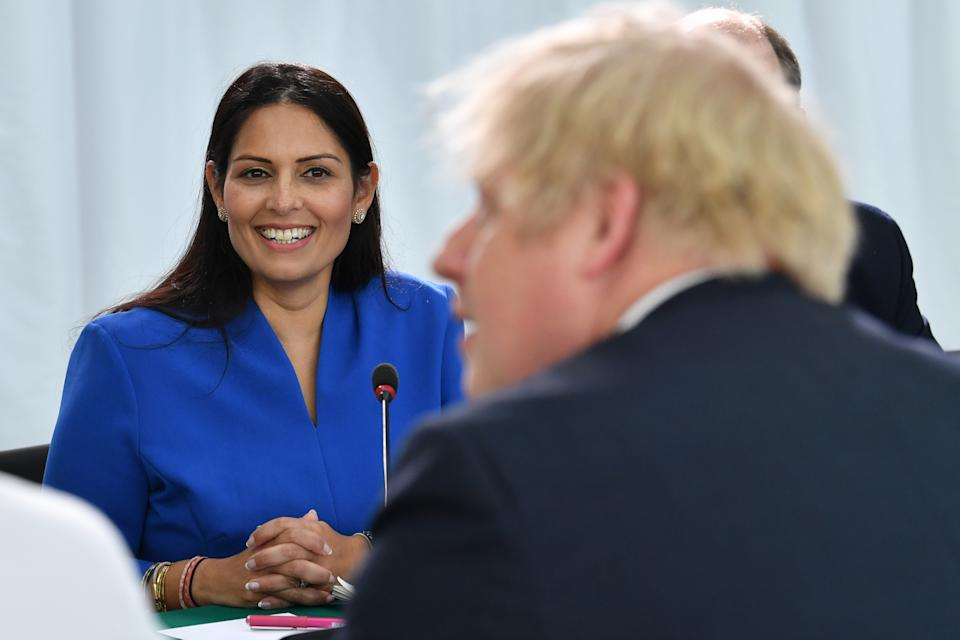 SUNDERLAND, ENGLAND - JANUARY 31: Home Secretary Priti Patel (L) looks on Britain's Prime Minister Boris Johnson chairs a cabinet meeting at the National Glass Centre at the University of Sunderland on January 31, 2020 in Sunderland, United Kingdom. (Photo by Paul Ellis - WPA Pool/Getty Images)