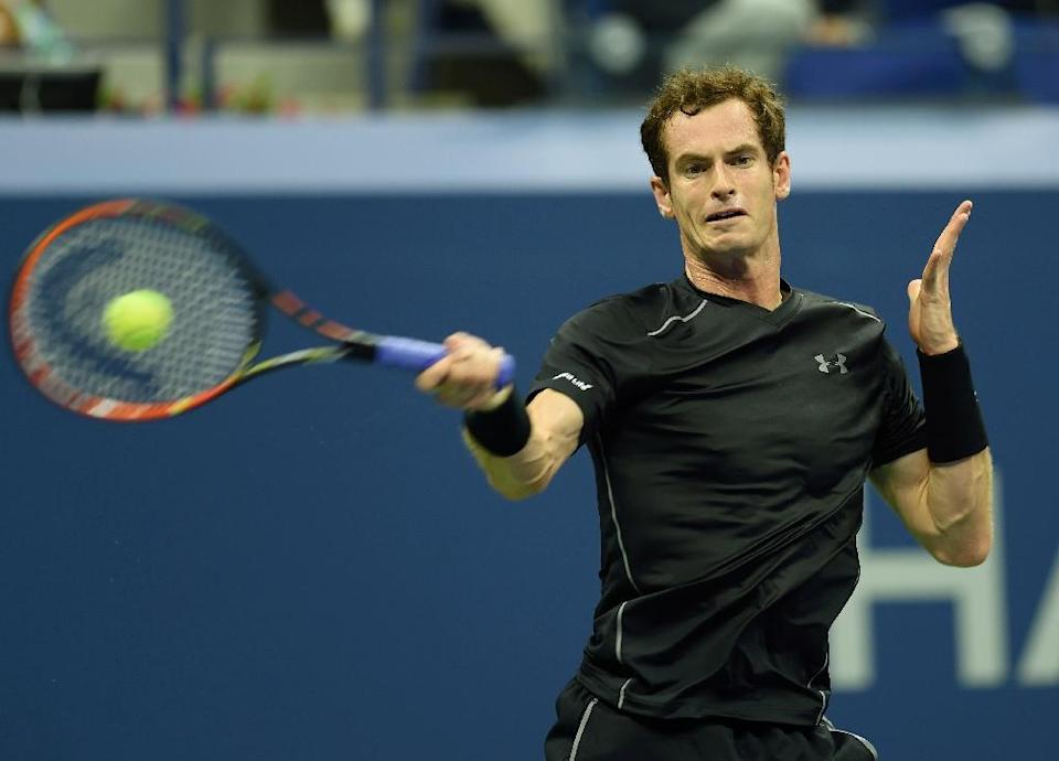 Andy Murray of Great Britain hits a return to Nick Kyrgios of Australia during their US Open 2015 first round men's singles match at the USTA Billie Jean King National Center September 1, 2015 in New York (AFP Photo/Don Emmert)