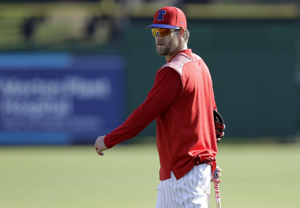 Philadelphia Phillies' Bryce Harper walks off the field after taking batting practice before a spring training baseball game against the Tampa Bay Rays Monday, March 11, 2019, in Clearwater, Fla. (AP Photo/Chris O'Meara)