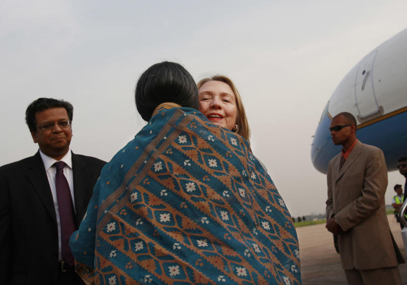 U.S. Secretary of State Hillary Rodham Clinton is greeted by Bangladeshi Foreign Minister Dipu Moni upon arrival at Hazrat Shahjalal International Airport in Dhaka, Bangladesh, Saturday, May 5, 2012. Clinton is in Bangladesh to press tolerance, democracy and development in one of the world's most impoverished nations that is now in the throes political turmoil. (AP Photo/Shannon Stapleton, Pool)