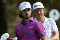 Abraham Ancer, left, of Mexico, and Cameron Smith, of Australia, wait to tee off on the fourth hole during the third round of the Masters golf tournament Saturday, Nov. 14, 2020, in Augusta, Ga. (AP Photo/David J. Phillip)