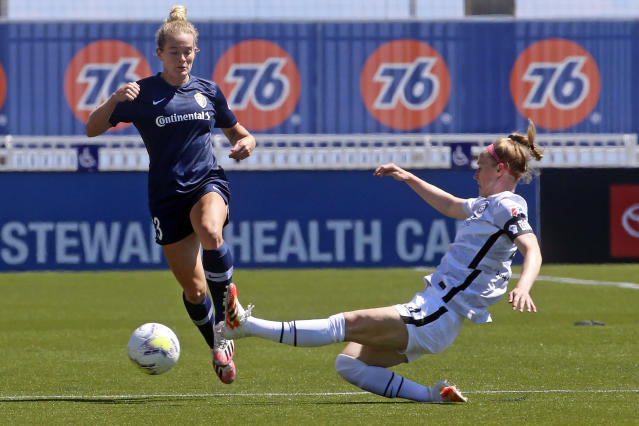 North Carolina Courage forward Kristen Hamilton (23) drives as Portland Thorns FC defender Becky Sauerbrunn (4) slides in with a challenge during the first half of an NWSL Challenge Cup soccer match at Zions Bank Stadium Saturday, June 27, 2020, in Herriman, Utah. (AP Photo/Rick Bowmer)