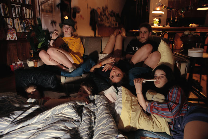 Girlfriends Watching Television During Slumber Party (Photo by mark peterson/Corbis via Getty Images)