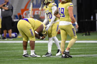 Alcorn State defensive lineman Kee Wayne Jones is consoled by defensive back Allen Bruce (20) after North Carolina A&T scored a touchdown during the second half of the Celebration Bowl NCAA college football game, Saturday, Dec. 21, 2019, in Atlanta. North Carolina A&T won 64-44. (John Amis/Atlanta Journal-Constitution via AP)