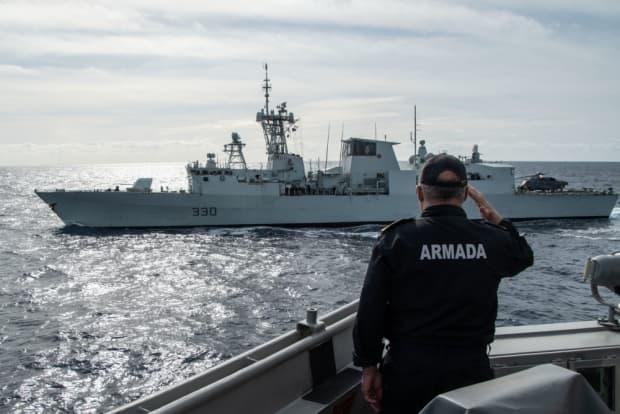 HMCS Halifax being saluted by a Spanish sailor during NATO Exercise Steadfast Defender.
