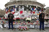 FILE PHOTO: French Republican guards stand during a ceremony at Place de la Republique square to pay tribute to the victims of last year's shooting at the French satirical newspaper Charlie Hebdo, in Paris