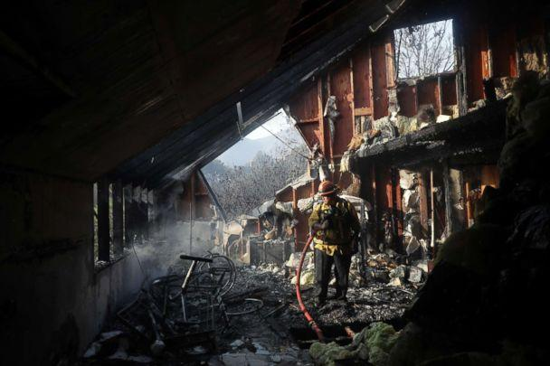 PHOTO: Capt. Adrian Murrieta with the Los Angeles County Fire Dept., looks for hot spots on a wildfire-ravaged home, Nov. 10, 2018, in Malibu, Calif. (Marcio Jose Sanchez/AP)