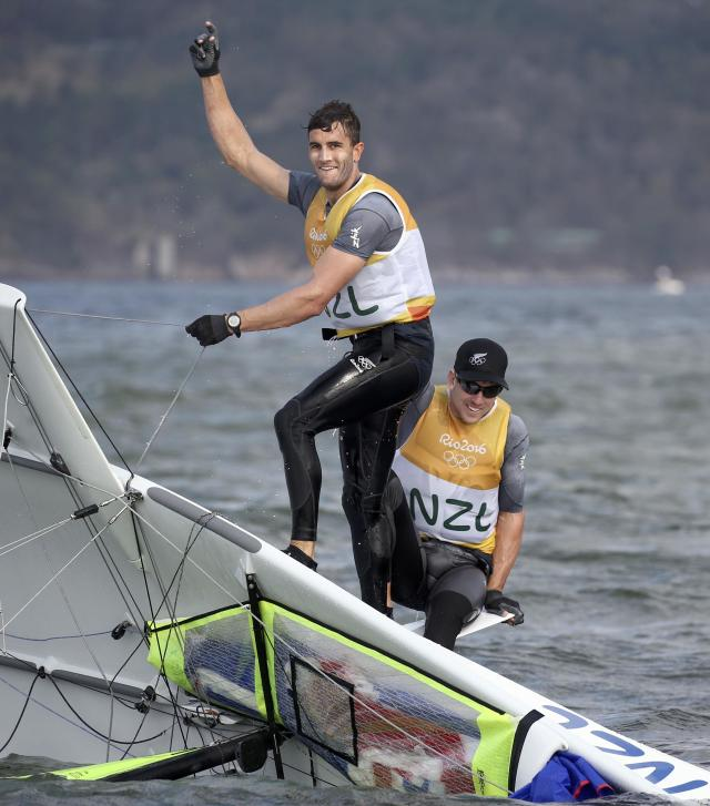 2016 Rio Olympics - Sailing - Final - Men's Skiff - 49er - Medal Race - Marina de Gloria - Rio de Janeiro, Brazil - 18/08/2016. Peter Burling (NZL) of New Zealand and Blair Tuke (NZL) of New Zealand celebrate gold medal. REUTERS/Benoit Tessier FOR EDITORIAL USE ONLY. NOT FOR SALE FOR MARKETING OR ADVERTISING CAMPAIGNS.