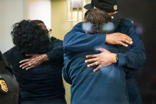 PHOTO:People hug after learning that their loved one is safe, April 16, 2021 in Indianapolis. (Mykal Mceldowney/Indianapolis Star-USA Today Network)