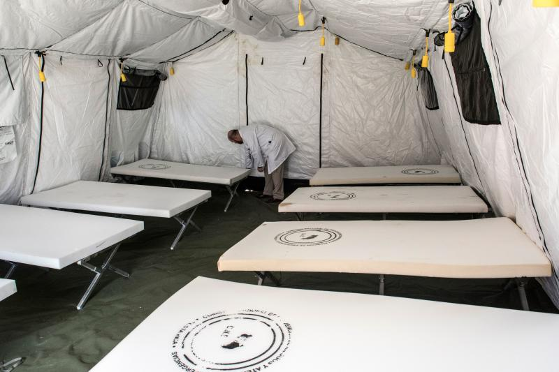 A medical doctor checks inputs inside a tent at a military hospital donated by the US government to assist COVID-19 cases in San Jose, Costa Rica, March 17, 2020. - Costa Rica has confirmed 50 cases of the new coronavirus. (Photo by Ezequiel BECERRA / AFP) (Photo by EZEQUIEL BECERRA/AFP via Getty Images)