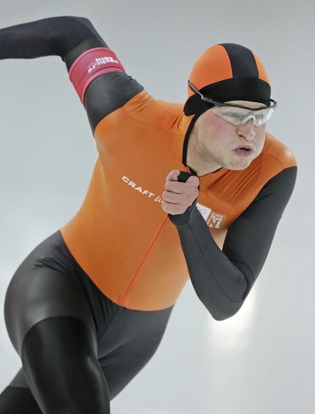 Sven Kramer of the Netherlands takes the start on his way to a new Olympic record in the men's 5,000-meter speedskating race at the Adler Arena Skating Center at the 2014 Winter Olympics in Sochi, Russia, Saturday, Feb. 8, 2014. (AP Photo/Matt Dunham)