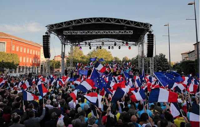 <p>Supporters of French independent centrist presidential candidate Emmanuel Macron wave flags during a campaign rally in Albi, southern France, Thursday, May 4, 2017. The 39-year-old independent candidate faces far-right National Front leader Marine Le Pen in Sunday's presidential runoff. (AP Photo/Christophe Ena) </p>