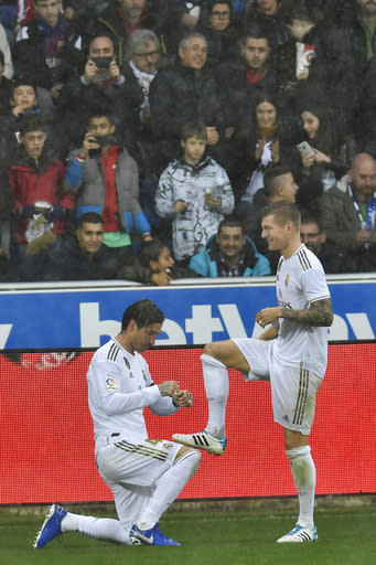 Real Madrid's RSergio Ramos celebrates his goal with teammate Toni Kroos after scoring during the Spanish La Liga soccer match between Real Madrid and Alaves at Mendizorroza stadium, in Vitoria, northern Spain, Saturday, Nov. 30, 2019. (AP Photo/Alvaro Barrientos)