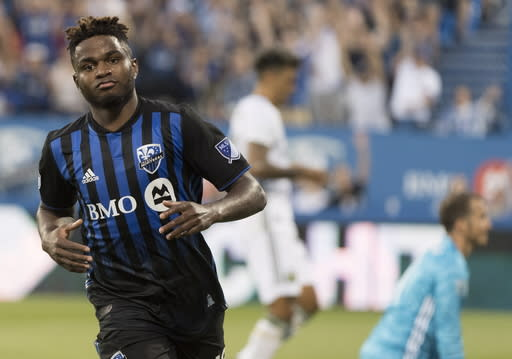 Montreal Impact's Orji Okwonkwo reacts after scoring against the Portland Timbers during the first half of an MLS soccer game in Montreal, Wednesday, June 26, 2019. (Graham Hughes/The Canadian Press via AP)