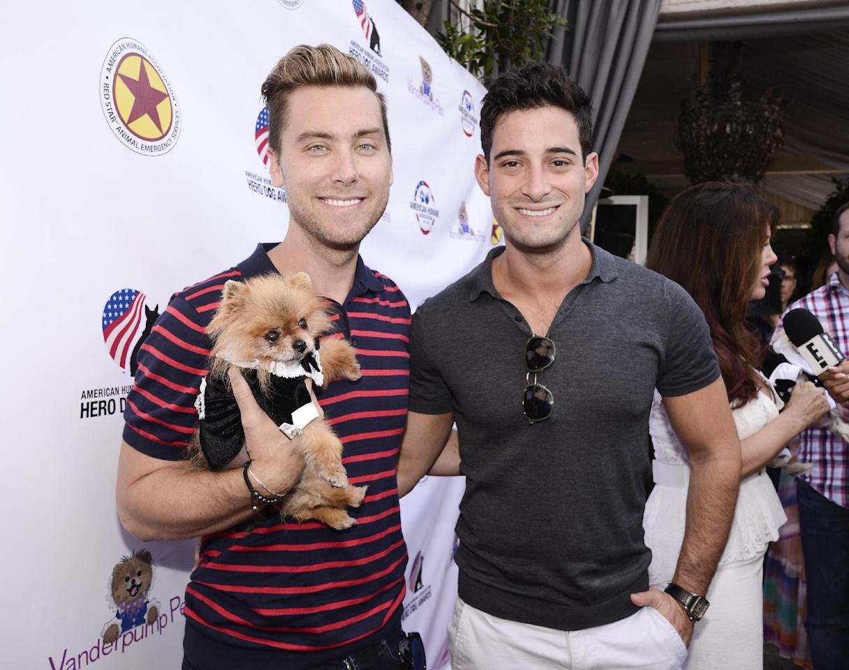 IMAGE DISTRIBUTED FOR AMERICAN HUMANE ASSOCIATION - Actor Lance Bass, left, his husband Michael Turchin, and Giggy attend the American Humane Association Luncheon hosted by Lisa Vanderpump and Vanderpump Pets at PUMP on Thursday, Aug. 13, 2015, in West Hollywood, Calif. (Photo by Dan Steinberg/Invision for American Humane Association/AP Images)