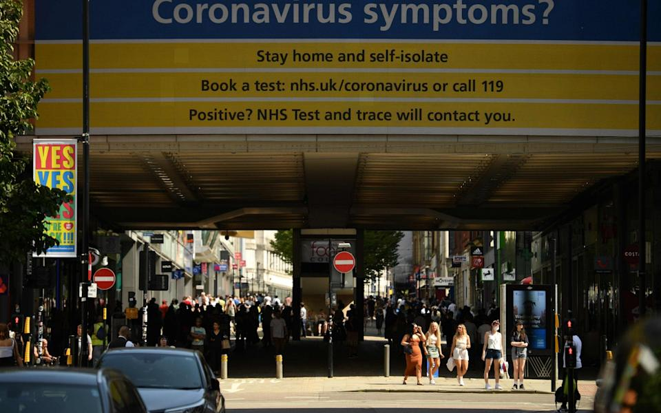 A coronavirus information screen is on view in the centre of Manchester, northwest England, on July 31, 2020 - Oli Scarff/AFP