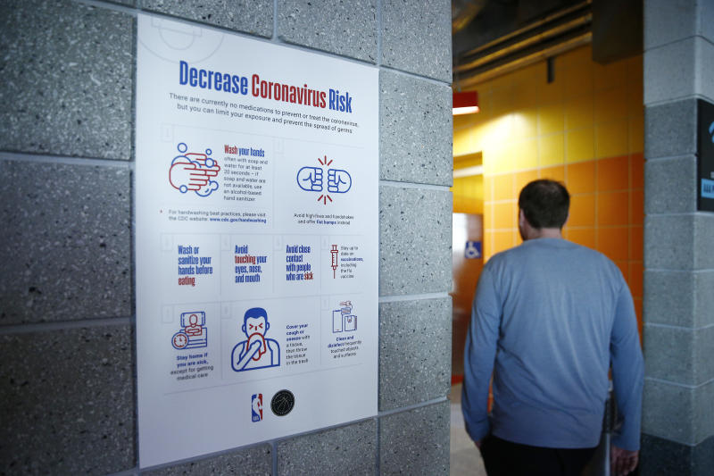 MIAMI, FLORIDA - MARCH 11: A detailed view of a coronavirus poster outside men's restroom prior to the game between the Miami Heat and the Charlotte Hornets at American Airlines Arena on March 11, 2020 in Miami, Florida. NOTE TO USER: User expressly acknowledges and agrees that, by downloading and/or using this photograph, user is consenting to the terms and conditions of the Getty Images License Agreement. (Photo by Michael Reaves/Getty Images)