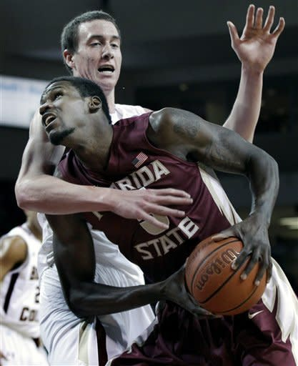 Florida State's Bernard James, front, drives against Boston College's Dennis Clifford during the first half of an NCAA college basketball game in Boston on Wednesday, Feb 8, 2012. (AP Photo/Elise Amendola)