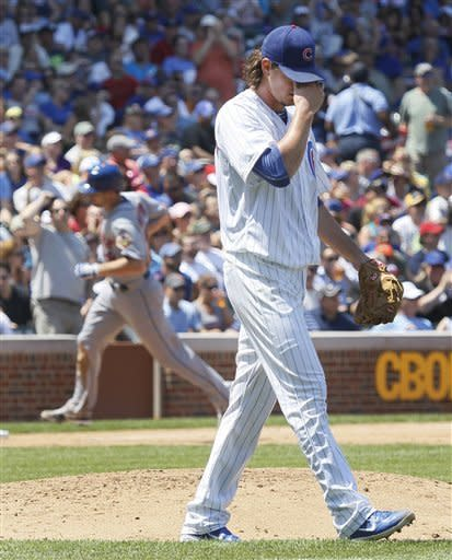 Chicago Cubs starting pitcher Jeff Samardzija reacts after giving up a two-run home run to New York Mets' Daniel Murphy, background, also scoring Ike Davis, during the fourth inning of a baseball game, Wednesday, June 27 2012, in Chicago. (AP Photo/Charles Rex Arbogast)