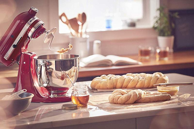 Is there a more iconic holiday kitchen scene than an Empire Red Kitchenaid churning out dough for a festive feast? We think not. (Photo: Amazon)